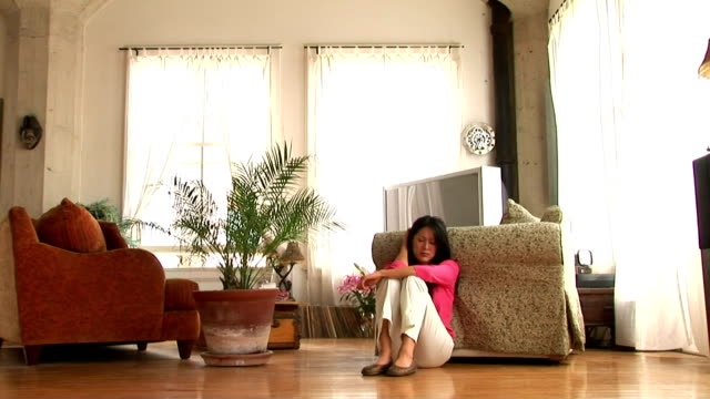 woman in living room - stargazer lily stock videos & royalty-free footage