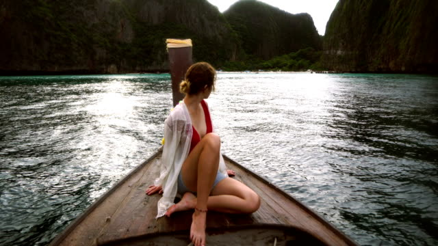 Woman in long tail boat