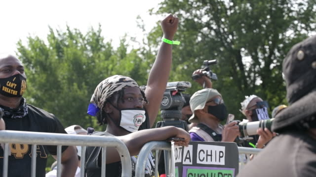woman in mask holding her fist up during march on washington in washington dc us on friday august 28 2020 - menschliche gliedmaßen stock-videos und b-roll-filmmaterial