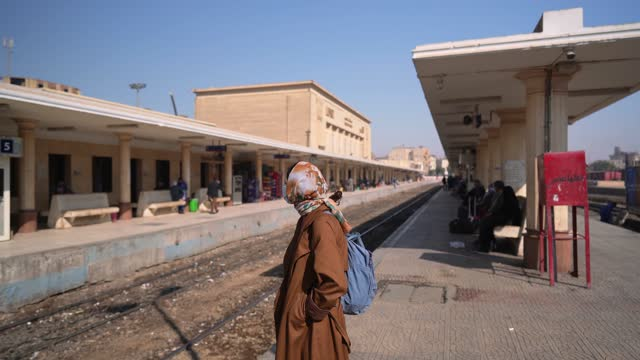 woman in mask on railway station in egypt during covid-19 - egypt stock videos & royalty-free footage