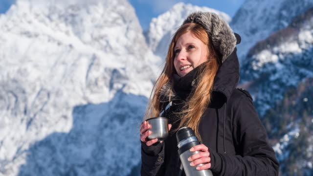 Woman in mountainous background in winter
