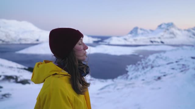 woman in mountains on lofoten island in snow - top garment stock videos & royalty-free footage