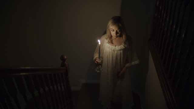 woman in nightgown walking on staircase with candle during storm at night / springville, utah, united states - springville utah stock videos & royalty-free footage