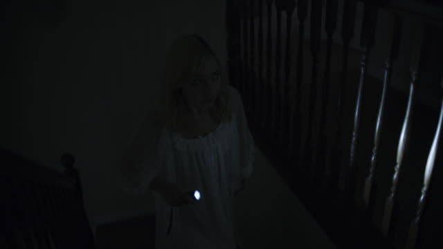 woman in nightgown walking on staircase with flashlight during storm at night / springville, utah, united states - springville utah stock videos & royalty-free footage