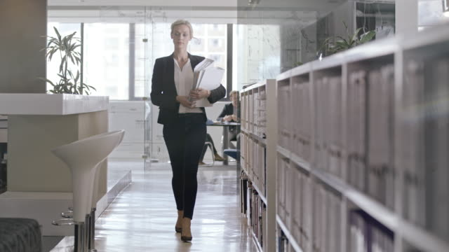 woman in office - file stock videos & royalty-free footage