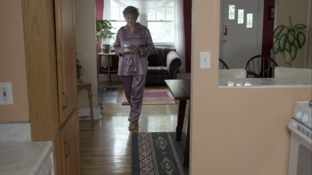 woman in pajamas dropping cup of tea. - pyjamas stock videos & royalty-free footage