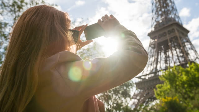 woman in paris photographing eiffel tower with smartphone - paris france stock videos & royalty-free footage