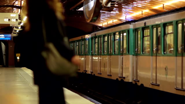 woman in parisian metro station - underground train stock videos & royalty-free footage