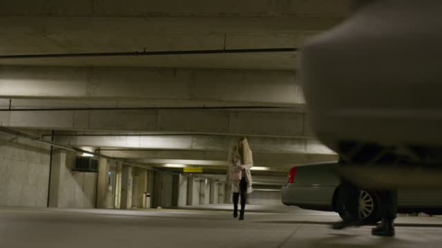 woman in parking garage fighting purse-snatcher in parking garage and escaping / provo, utah, united states - garage video stock e b–roll
