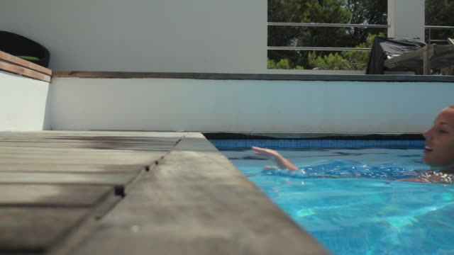 ms woman in pool at luxury beach house / port d'andratx, mallorca, spain - majorca stock videos & royalty-free footage