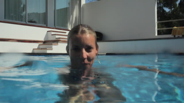 CU TU Woman in pool at luxury beach house / Port D'Andratx, Mallorca, Spain