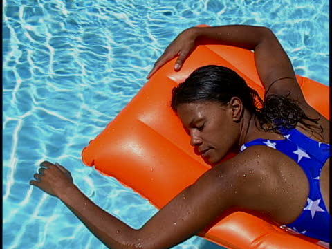 woman in pool - turquoise coloured stock videos & royalty-free footage
