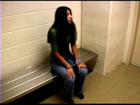 woman in prison cell  - manette video stock e b–roll