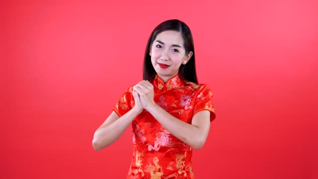 woman in qipao chinese dress - chinese language stock videos & royalty-free footage