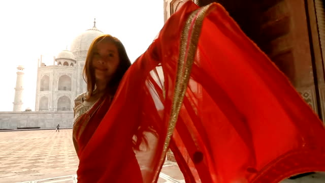 woman in red saree/sari in the taj mahal, agra, uttar pradesh, india - palace stock videos & royalty-free footage