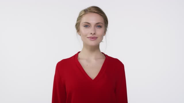 woman in red top walking against white background - white background stock videos & royalty-free footage