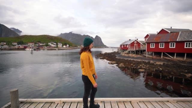 woman in reine village in lofoten islands - nordland county stock videos & royalty-free footage