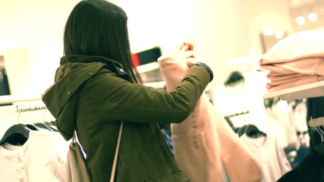 woman in shop looking for clothes - hooded top stock videos & royalty-free footage