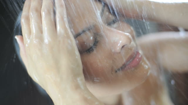 woman in shower - shower stock videos & royalty-free footage