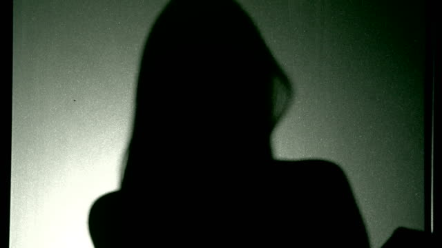 woman in silhouette - obscured face stock videos & royalty-free footage