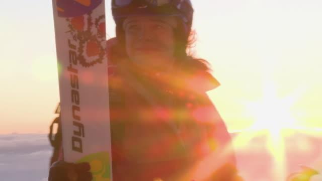 cu woman in skiwear standing at top of ski area at sunrise / alta, snowbird, utah, usa - alta utah stock videos & royalty-free footage