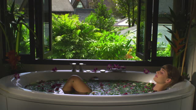 MS Woman in spa bath with rose-petals, Krabi, Thailand
