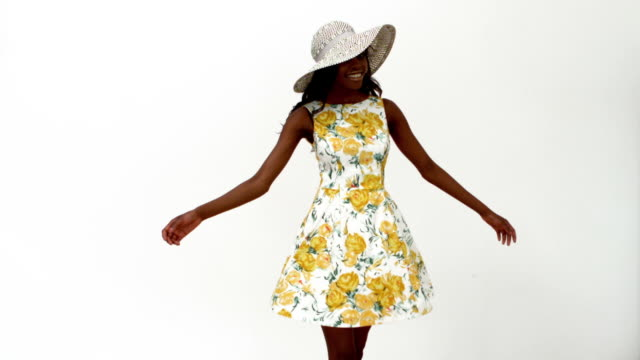 Woman in summer dress spinning around