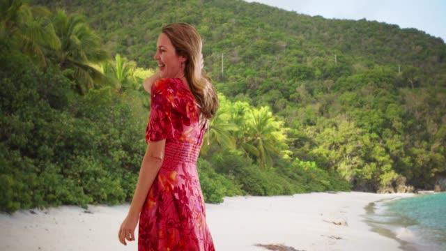 woman in sundress dancing, enjoying vacation or holiday on st. john's island - st. john virgin islands stock videos & royalty-free footage