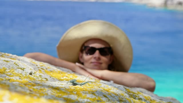woman in sunglasses and sun hat watching lizard on rocks - sun hat stock videos & royalty-free footage