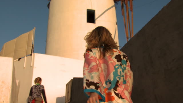 a woman in sunglasses going up stairs in mykonos - see other clips from this shoot 1144 stock videos & royalty-free footage