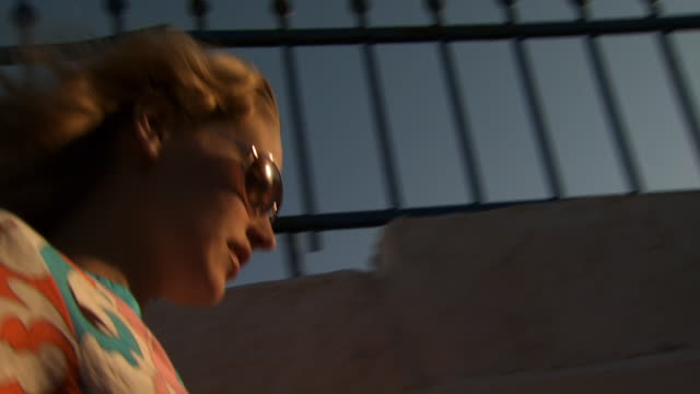 a woman in sunglasses in mykonos - see other clips from this shoot 1144 stock videos & royalty-free footage