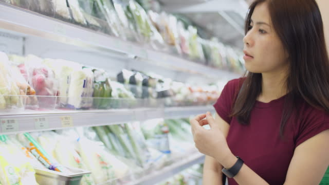 woman  in supermarket - shelf stock videos and b-roll footage