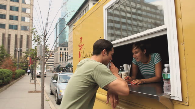 MS Woman in taco truck taking order from man / Jersey City, New Jersey, USA