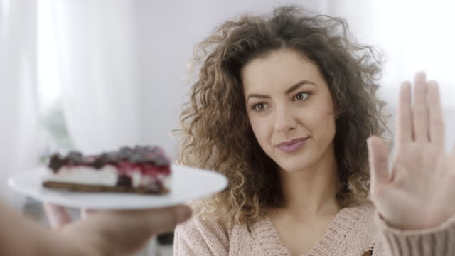 woman in temptation refusing slice of cake - unhealthy eating stock videos & royalty-free footage