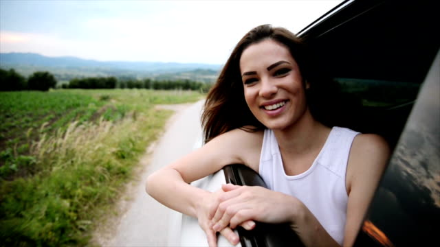 Woman in the car. Slow motion