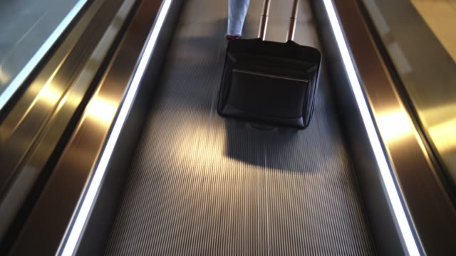 woman in the escalator at the airport - only mid adult women stock videos & royalty-free footage