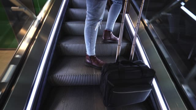 woman in the escalator at the airport - escalator stock videos & royalty-free footage