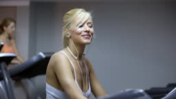 HD: Woman In the gym on treadmill