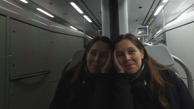 woman in the metro - spegling bildbanksvideor och videomaterial från bakom kulisserna