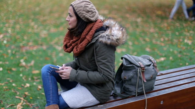 woman in the park using phone - czech republic stock videos and b-roll footage