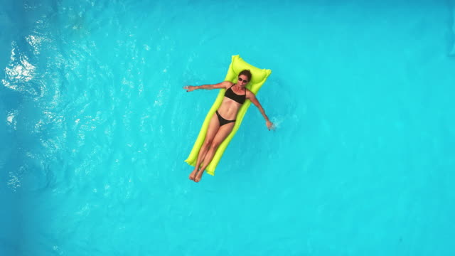 woman in the swimming pool - inflatable raft stock videos and b-roll footage