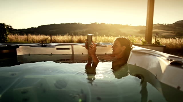woman in thermal bath with digital tablet - tourist resort stock videos and b-roll footage