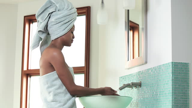 woman in towel washing hands with soap in bathroom sink - wrapped in a towel stock videos and b-roll footage