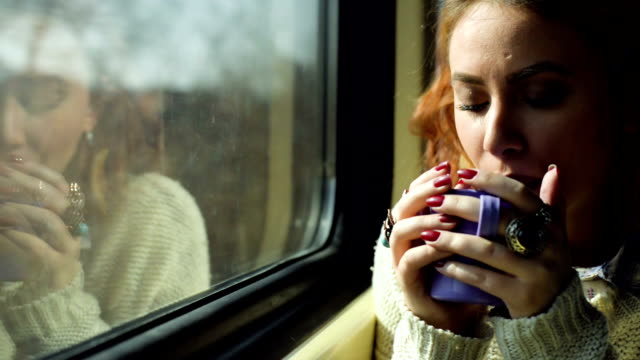 woman in train drinking tea - hot drink stock videos and b-roll footage