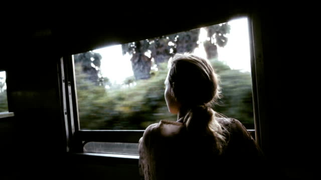 Woman in train in Thailand