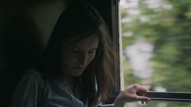 Woman in train looking at smart phone