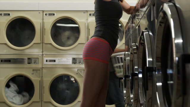 woman in underwear at laundromat - launderette stock videos and b-roll footage
