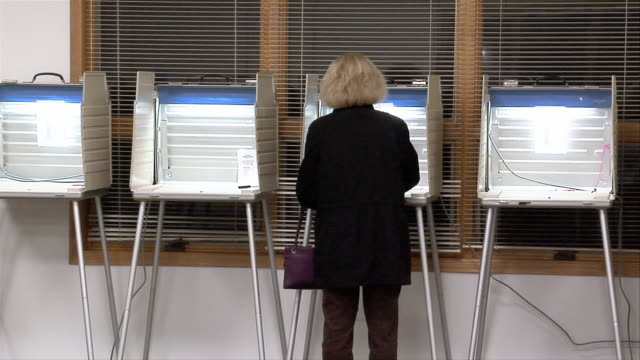ms, woman in voting booth, rear view, ypsilanti, michigan, usa - ypsilanti stock videos & royalty-free footage