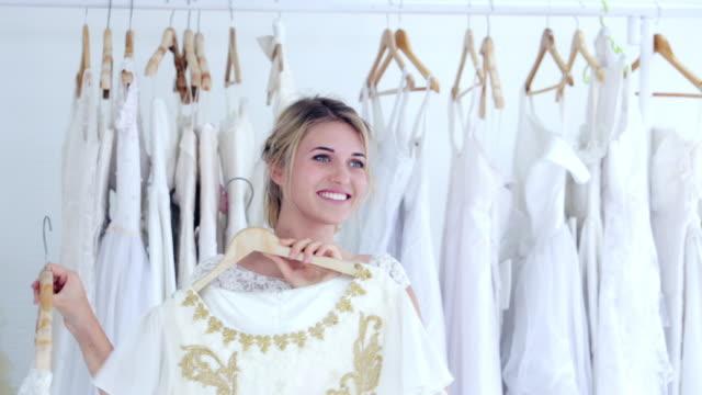 woman in wedding dress shop, choosing wedding dress - engagement stock videos and b-roll footage