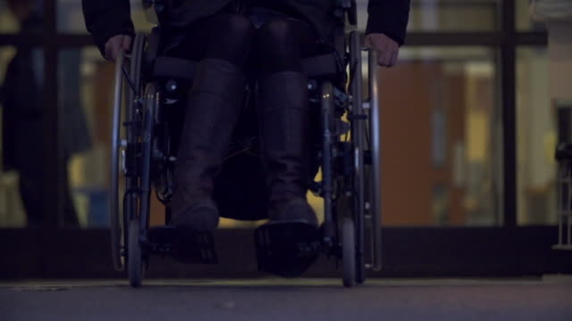 woman in wheelchair exits building - wheelchair stock videos and b-roll footage